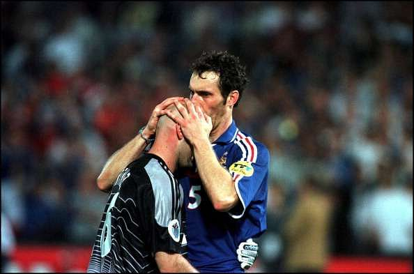 Blanc kissing the head of Barthez before a game
