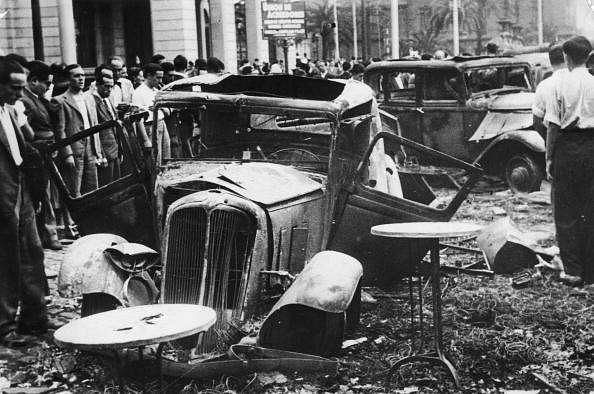 July 1936:  Burned out cars on a street after Franco