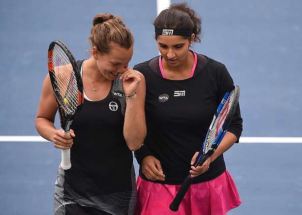 DUBAI, UNITED ARAB EMIRATES - FEBRUARY 24:  Sania Mirza of India and Barbora Strycova of Czech Republic celebrate discuss tactics during their semi final match against Ekaterina Makarova of Russia and Elena Vesnina of Russia on day six of the WTA Dubai Duty Free Tennis Championship at the Dubai Tennis Stadium on February 24, 2017 in Dubai, United Arab Emirates.  (Photo by Tom Dulat/Getty Images)