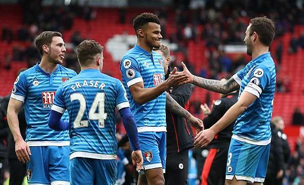 MANCHESTER, ENGLAND - MARCH 04: Tyrone Mings of AFC Bournemouth (C) celebrates with Steve Cook of AFC Bournemouth (R) after the Premier League match between Manchester United and AFC Bournemouth at Old Trafford on March 4, 2017 in Manchester, England.  (Photo by Julian Finney/Getty Images)