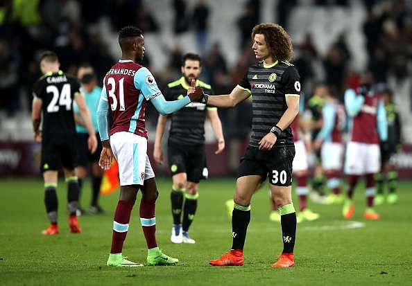 STRATFORD, ENGLAND - MARCH 06:  Edmilson Fernandes of West Ham United shakes hands with David Luiz of Chelsea during the Premier League match between West Ham United and Chelsea at London Stadium on March 6, 2017 in Stratford, England.  (Photo by Julian Finney/Getty Images)
