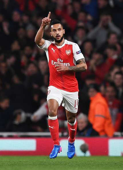 LONDON, ENGLAND - MARCH 07:  Theo Walcott of Arsenal celebrates as he scores their first goal during the UEFA Champions League Round of 16 second leg match between Arsenal FC and FC Bayern Muenchen at Emirates Stadium on March 7, 2017 in London, United Kingdom.  (Photo by Shaun Botterill/Getty Images)