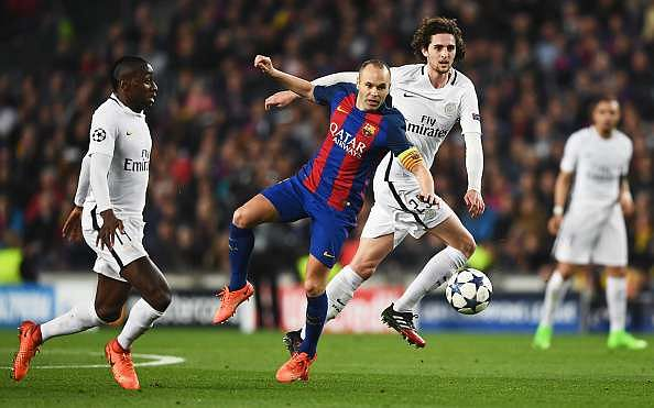 BARCELONA, SPAIN - MARCH 08:  Andres Iniesta of Barcelona battles with Adrien Rabiot ofAdrien Rabiot of PSG (25) during the UEFA Champions League Round of 16 second leg match between FC Barcelona and Paris Saint-Germain at Camp Nou on March 8, 2017 in Barcelona, Spain.  (Photo by Laurence Griffiths/Getty Images)