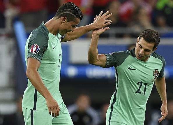 Cedric Soares with Cristiano Ronaldo