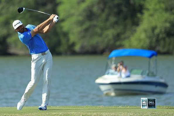 AUSTIN, TX - MARCH 26: Dustin Johnson tees off on the 14th hole during the final match of the World Golf Championships-Dell Technologies Match Play at the Austin Country Club on March 26, 2017 in Austin, Texas. (Photo by Richard Heathcote/Getty Images)