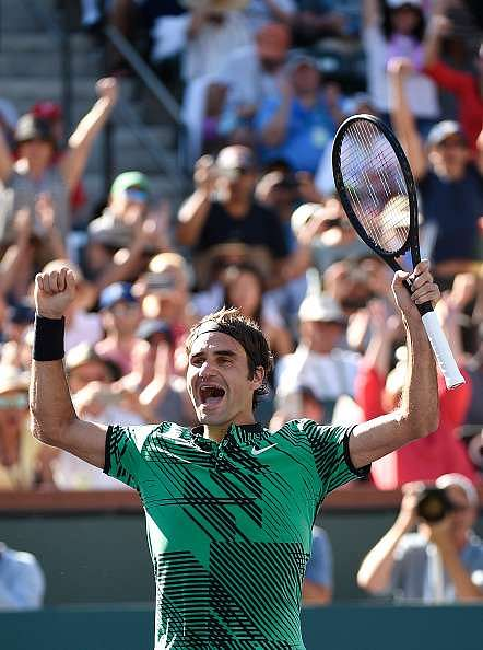 INDIAN WELLS, CA - MARCH 19: Roger Federer of Switzerland celebrates after defeating Stanislas Wawrinka of Switzerland in the mens final during day fourteen of the BNP Paribas Open at Indian Wells Tennis Garden on March 19, 2017 in Indian Wells, California. (Photo by Kevork Djansezian/Getty Images)