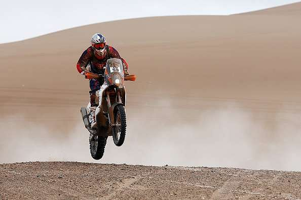 IQUIQUE, CHILE - JANUARY 13:  #59 Santosh Chunchunguppe Shivashankar, better known as CS Santosh for the KTM Rally Factory Team competes in the Atacama Desert during day 10 of the Dakar Rallly between Iquique on Calama January 13, 2015 in Iquique, Chile.  (Photo by Dean Mouhtaropoulos/Getty Images)