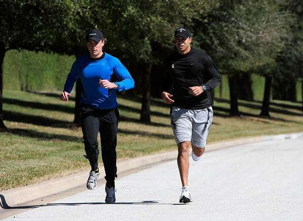 ORLANDO, FL - FEBRUARY 17:  Tiger Woods (R) jogs with an unidentified friend near his home on February 17, 2010 in Orlando, Florida. The PGA Tour has just announced that Tiger Woods will make a statement this Friday morning (February 19, 2010) at their headquarters. (Photo by Sam Greenwood/Getty Images)