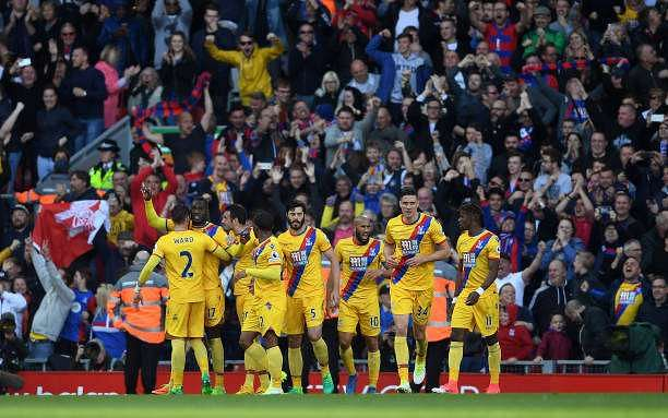 LIVERPOOL, ENGLAND - APRIL 23:  Christian Benteke (2nd L) of Crystal Palace celebrates his side