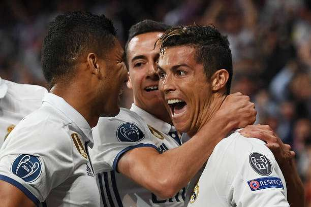 MADRID, SPAIN - APRIL 18: Cristiano Ronaldo of Real Madrid celebrates scoring his sides first goal with his Real Madrid team mates during the UEFA Champions League Quarter Final second leg match between Real Madrid CF and FC Bayern Muenchen at Estadio Santiago Bernabeu on April 18, 2017 in Madrid, Spain.  (Photo by Shaun Botterill/Getty Images)