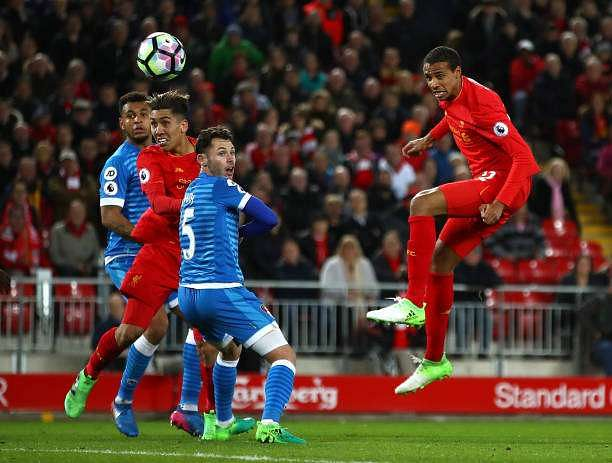 LIVERPOOL, ENGLAND - APRIL 05: Joel Matip of Liverpool shoots on goal during the Premier League match between Liverpool and AFC Bournemouth at Anfield on April 5, 2017 in Liverpool, England.  (Photo by Clive Brunskill/Getty Images)