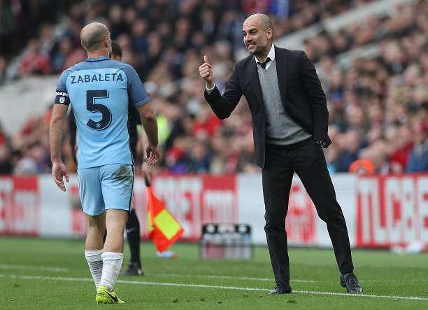 MIDDLESBROUGH, ENGLAND - MARCH 11: Josep Guardiola, Manager of Manchester City (R) speaks to Pablo Zabaleta of Manchester City (L) during The Emirates FA Cup Quarter-Final match between Middlesbrough and Manchester City at Riverside Stadium on March 11, 2017 in Middlesbrough, England.  (Photo by Ian MacNicol/Getty Images)