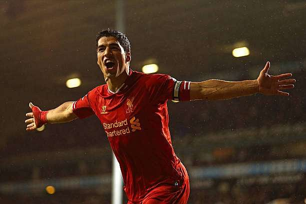 LONDON, ENGLAND - DECEMBER 15:  Luis Suarez of Liverpool celebrates scoring their fourth goal during the Barclays Premier League match between Tottenham Hotspur and Liverpool at White Hart Lane on December 15, 2013 in London, England.  (Photo by Paul Gilham/Getty Images)