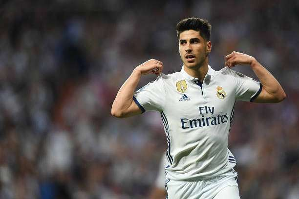 MADRID, SPAIN - APRIL 18:  Marco Asensio of Real Madrid celebrates scoring his sides fourth goal during the UEFA Champions League Quarter Final second leg match between Real Madrid CF and FC Bayern Muenchen at Estadio Santiago Bernabeu on April 18, 2017 in Madrid, Spain.  (Photo by Shaun Botterill/Getty Images)