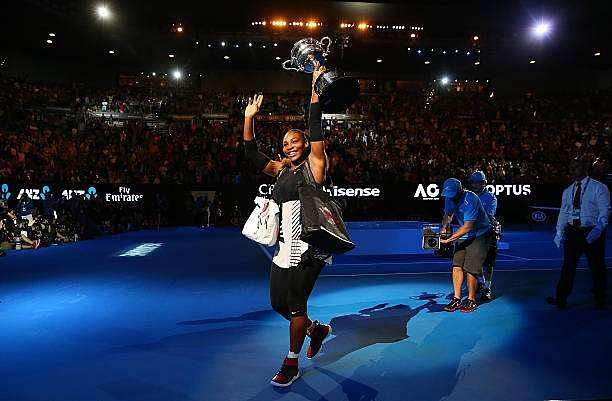 MELBOURNE, AUSTRALIA - JANUARY 28:  Serena Williams waves to the crowd as she leaves the court with the Daphne Akhurst Trophy after winning the Women