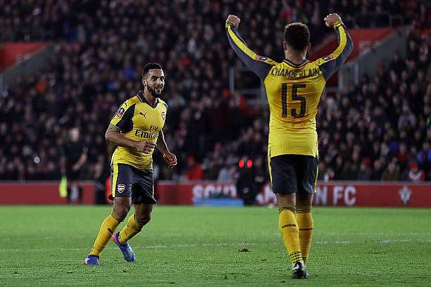 SOUTHAMPTON, ENGLAND - JANUARY 28:  Theo Walcott of Arsenal celebrates after scoring his sides fourth goal with Alex Oxlade-Chamberlain of Arsenal during the Emirates FA Cup Fourth Round match between Southampton and Arsenal at St Mary
