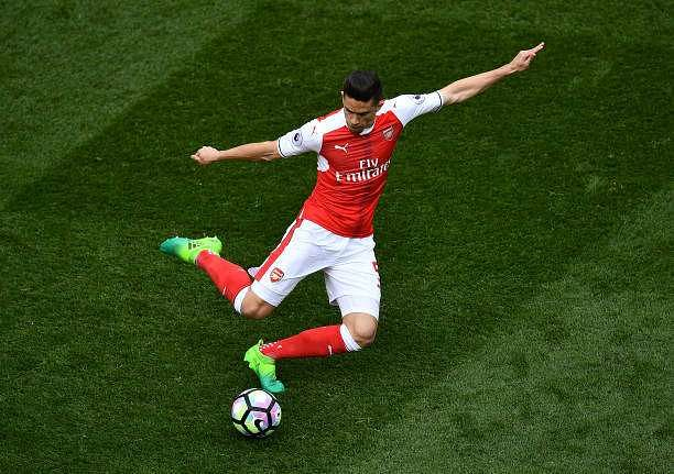 LONDON, ENGLAND - APRIL 30:  Gabriel Paulista of Arsenal lines up a pass during the Premier League match between Tottenham Hotspur and Arsenal at White Hart Lane on April 30, 2017 in London, England. (Photo by Dan Mullan/Getty Images)