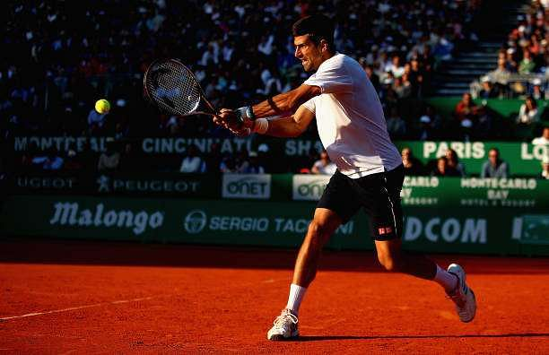 MONTE-CARLO, MONACO - APRIL 21:  Novak Djokovic of Serbia plays a backhand against David Goffin of Belgium in their quarter final round match on day six of the Monte Carlo Rolex Masters at Monte-Carlo Sporting Club on April 21, 2017 in Monte-Carlo, Monaco.  (Photo by Clive Brunskill/Getty Images)