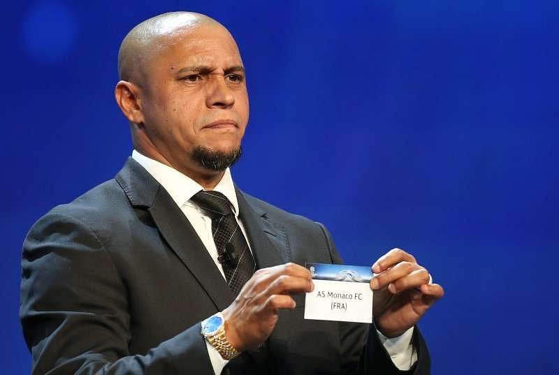 Former Brazilian soccer player Roberto Carlos holds a paper with the name of AS Monaco FC during the draw ceremony for the 2016/2017 Champions League Cup soccer competition at Monaco