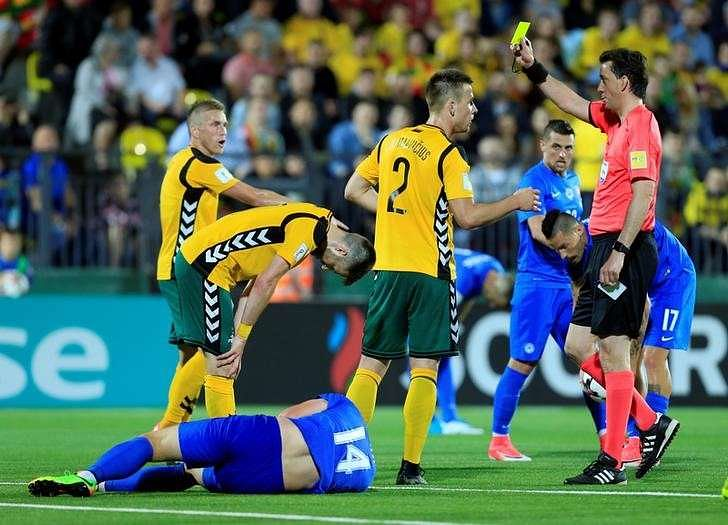 Football Soccer - Lithuania v Slovakia - 2018 World Cup Qualifying European Zone - Group F - LFF Stadium, Vilnius - June 10, 2017 Lithuania's Linas Klimavicius is shown a yellow card by referee Manuel Grafe Reuters / Ints Kalnins