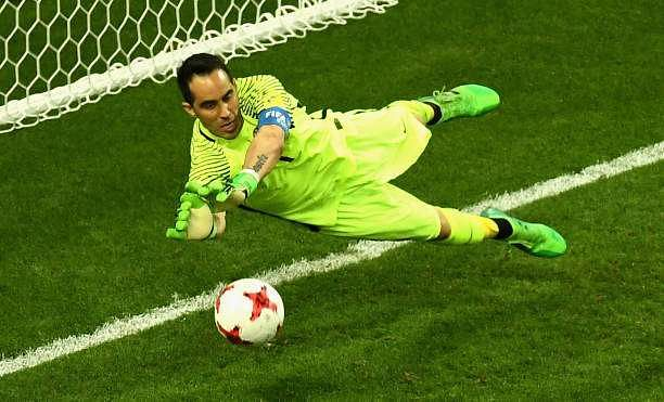KAZAN, RUSSIA - JUNE 28:  Claudio Bravo of Chile saves Portugal second penatly during the penalty shoot out during the FIFA Confederations Cup Russia 2017 Semi-Final between Portugal and Chile at Kazan Arena on June 28, 2017 in Kazan, Russia.  (Photo by Laurence Griffiths/Getty Images)