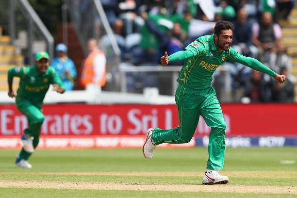 CARDIFF, WALES - JUNE 12:  Mohammad Amir of Pakistan celebrates  taking the wicket of Niroshan Dickwella of Sri Lanka during the ICC Champions Trophy match between Sri Lanka and Pakistan at the SWALEC Stadium on June 12, 2017 in Cardiff, Wales.  (Photo by Michael Steele/Getty Images)