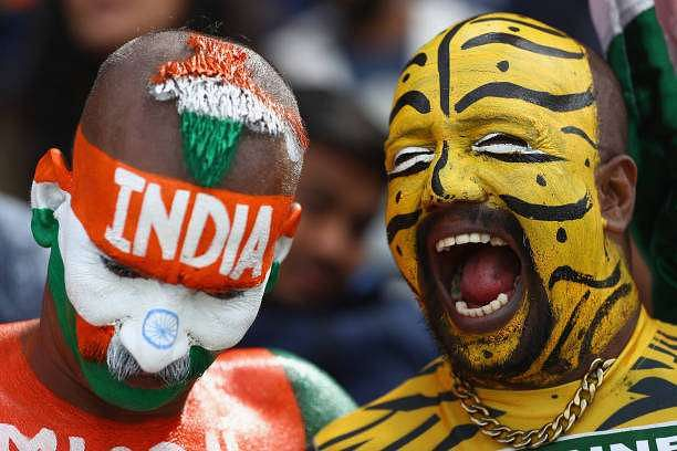 BIRMINGHAM, ENGLAND - JUNE 15:  Painted faces of Bangladesh and India supporters look on during the ICC Champions Trophy Semi-Final match between Bangladesh and India at Edgbaston on June 15, 2017 in Birmingham, England.  (Photo by Michael Steele/Getty Images)