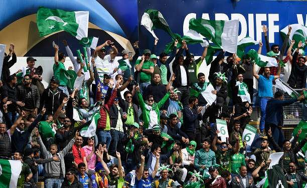 CARDIFF, WALES - JUNE 12: Pakistan fans celebrate a boundary  during the ICC Champions League match between Sri Lanka and Pakistan at SWALEC Stadium on June 12, 2017 in Cardiff, Wales.  (Photo by Stu Forster/Getty Images)