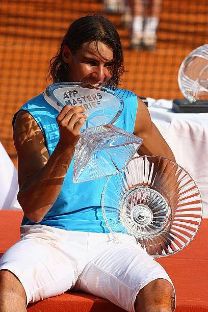 MONTE CARLO, MONACO - APRIL 27:  Rafael Nadal of Spain bites the Masters Trophy after his 7-5,7-5 victory in the singles final match against Roger Federer of Switzerland on day nine of the Masters Series at the Monte Carlo Country Club, April 27, 2008 in Monte Carlo, Monaco.  (Photo by Michael Steele/Getty Images)