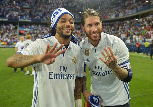 MALAGA, SPAIN - MAY 21:  Sergio Ramos of Real Madrid and Marcelo of Real Madrid celebrate winning the title after the La Liga match between Malaga and Real Madrid at La Rosaleda Stadium on May 21, 2017 in Malaga, Spain.  (Photo by Aitor Alcalde/Getty Images)