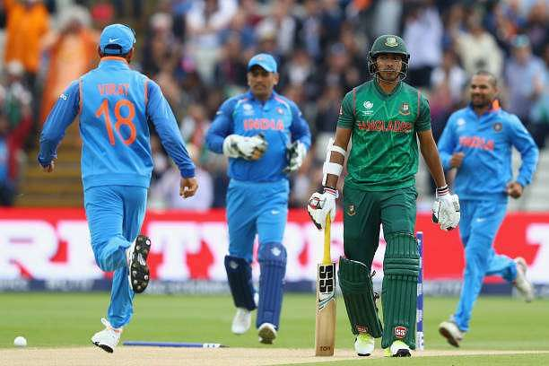 BIRMINGHAM, ENGLAND - JUNE 15:  Soumya Sarkar of Bangladesh hads back to the pavillion after being bowled by Bhuvneshwar Kumar of India during the ICC Champions Trophy Semi-Final match between Bangladesh and India at Edgbaston on June 15, 2017 in Birmingham, England.  (Photo by Michael Steele/Getty Images)