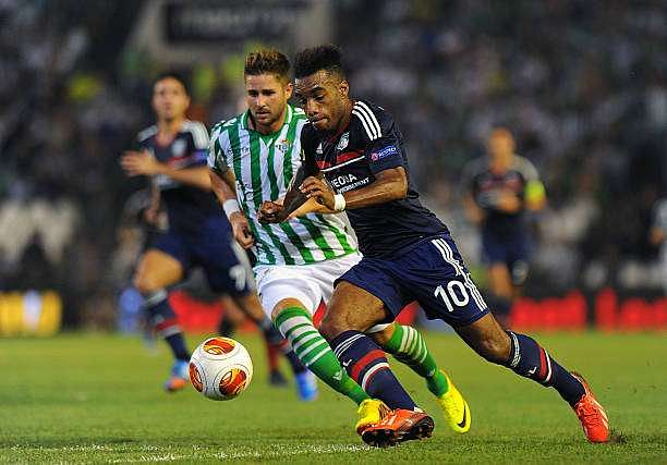SEVILLE, SPAIN - SEPTEMBER 19:  Alexandre Lacazette (R) of Olympique Lyonnais and Markus Steinhofer of Real Betis Balompie in action during the UEFA Europa League group stage match between Real Betis Balompie and Olympique Lyonnais held on September 19, 2013 at the Benito Villamarin Stadium, in Seville, Spain. (Photo by Jorge Guerrero/EuroFootball/Getty Images)