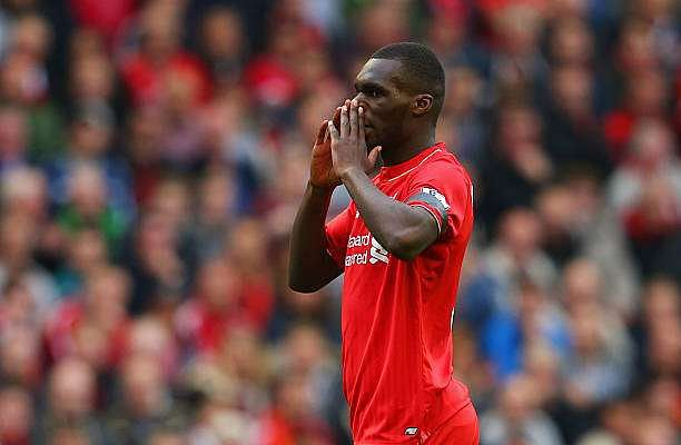 LIVERPOOL, ENGLAND - SEPTEMBER 20:  Christian Benteke of Liverpool reacts during the Barclays Premier League match between Liverpool and Norwich City at Anfield on September 20, 2015 in Liverpool, United Kingdom.  (Photo by Alex Livesey/Getty Images)
