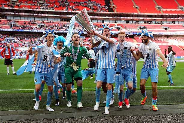LONDON, ENGLAND - APRIL 02:  Coventry City celebrate with the trophy after winning the EFL Checkatrade Trophy Final between Coventry City v Oxford United at Wembley Stadium on April 2, 2017 in London, England.  (Photo by Bryn Lennon/Getty Images)