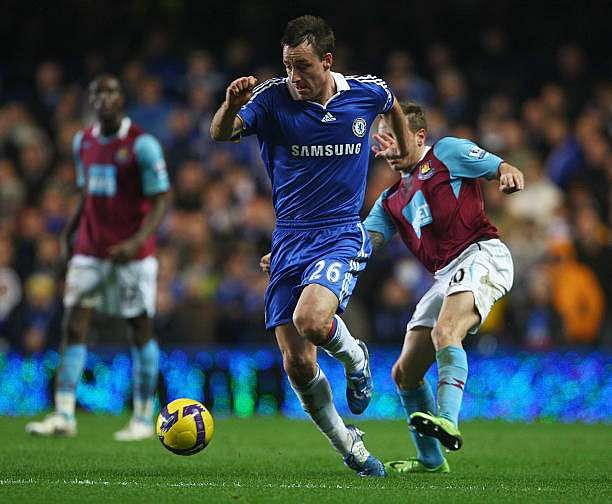LONDON - DECEMBER 14:  Craig Bellamy of West Ham United trips John Terry of Chelsea during the Barclays Premier League match between Chelsea and West Ham United at Stamford Bridge on December 14, 2008 in London, England.  (Photo by Phil Cole/Getty Images)