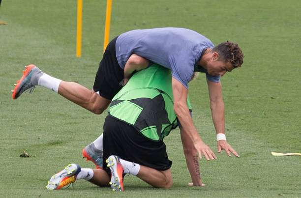 MADRID, SPAIN - MAY 30:  Cristiano Ronaldo of Real Madrid CF falls over his teammate Fabio Coentrao during training at the Real Madrid UEFA Open Media Day at Valdebebas training ground on May 30, 2017 in Madrid, Spain.  (Photo by Denis Doyle/Getty Images )