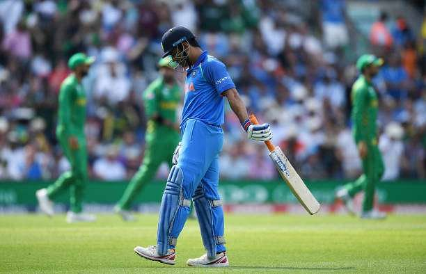 LONDON, ENGLAND - JUNE 18:  MS Dhoni of India leaves the field after being caught out by Imad Wasim of Pakistan during the ICC Champions Trophy Final between India and Pakistan at The Kia Oval on June 18, 2017 in London, England.  (Photo by Gareth Copley/Getty Images)