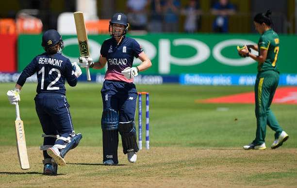 BRISTOL, ENGLAND - JULY 05:  England batsman Sarah Taylor (r) celebrates her century with fellow century maker Tammy Beaumont during the ICC Women