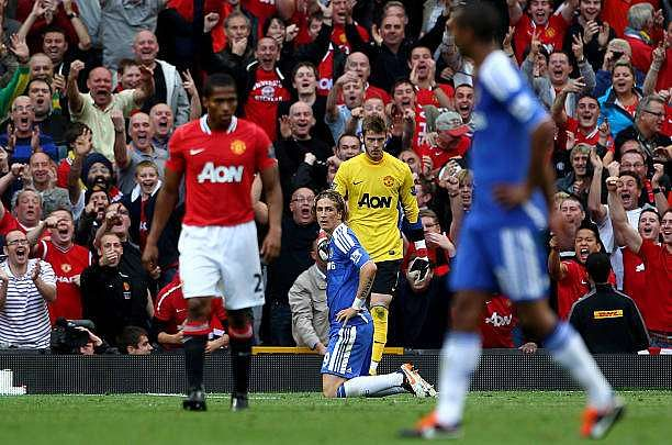 MANCHESTER, ENGLAND - SEPTEMBER 18:  Fernando Torres of Chelsea reacts after missing an open goal during the Barclays Premier League match between Manchester United and Chelsea at Old Trafford on September 18, 2011 in Manchester, England.  (Photo by Clive Brunskill/Getty Images)