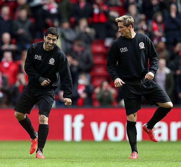 LIVERPOOL, ENGLAND - MARCH 29: Luis Suarez and Fernando Torres of the Gerrard XI warm up ahead of the Liverpool All-Star Charity match at Anfield on March 29, 2015 in Liverpool, England. (Photo by Chris Brunskill/Getty Images)