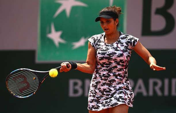PARIS, FRANCE - MAY 31:  Sania Mirza of India partner of Yaroslava Shvedova of Kazakhstan plays a forehand during the ladies doubles first round match against Daria Gavrilova of Australia and Anastasia Pavlyuchenkova of Russia on day four of the 2017 French Open at Roland Garros on May 31, 2017 in Paris, France.  (Photo by Clive Brunskill/Getty Images)